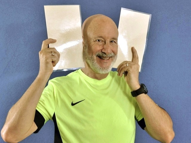 Chris Beatty demonstrates how to hear your true voice using a pair of file folders